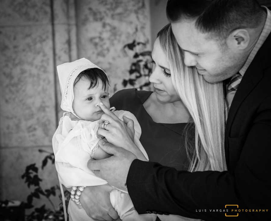 Mia with her God Parents after the Baptism
