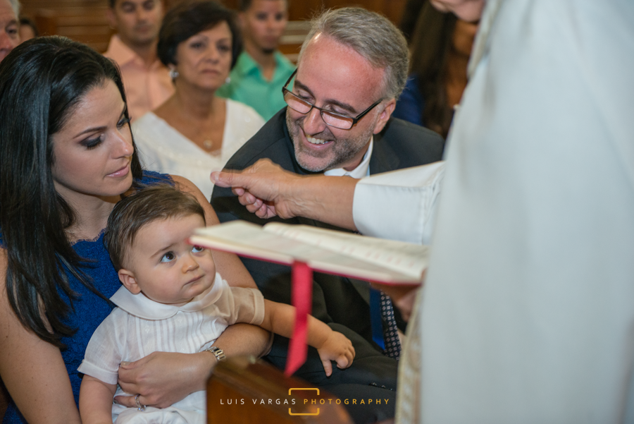 Baby Antonio getting blessed by the priest