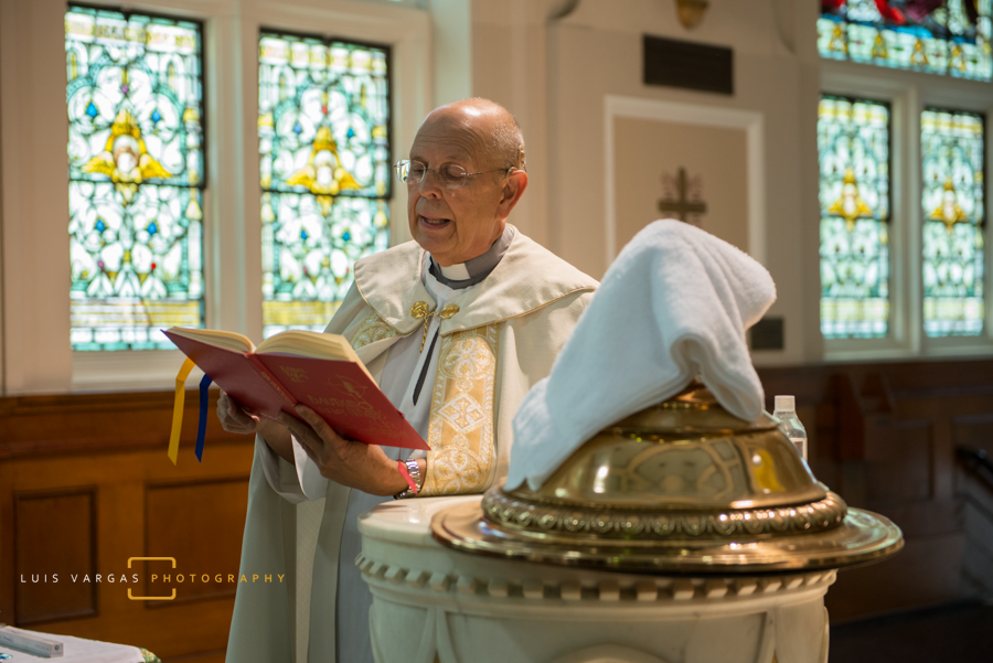 Priest during the baptism ceremony
