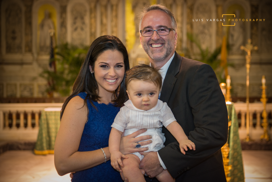 Baby Antonio with his mom and dad after the baptism
