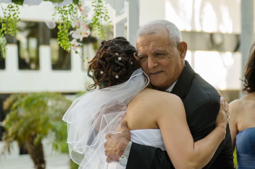 The bride hugging her father after the wedding