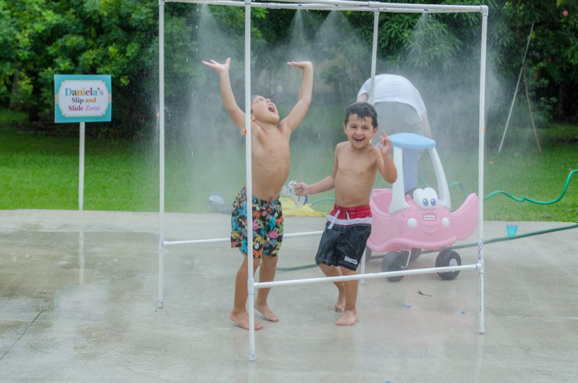 The kids enjoying the mini car wash
