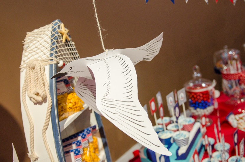 Custom made bird cutouts were displayed over the main table