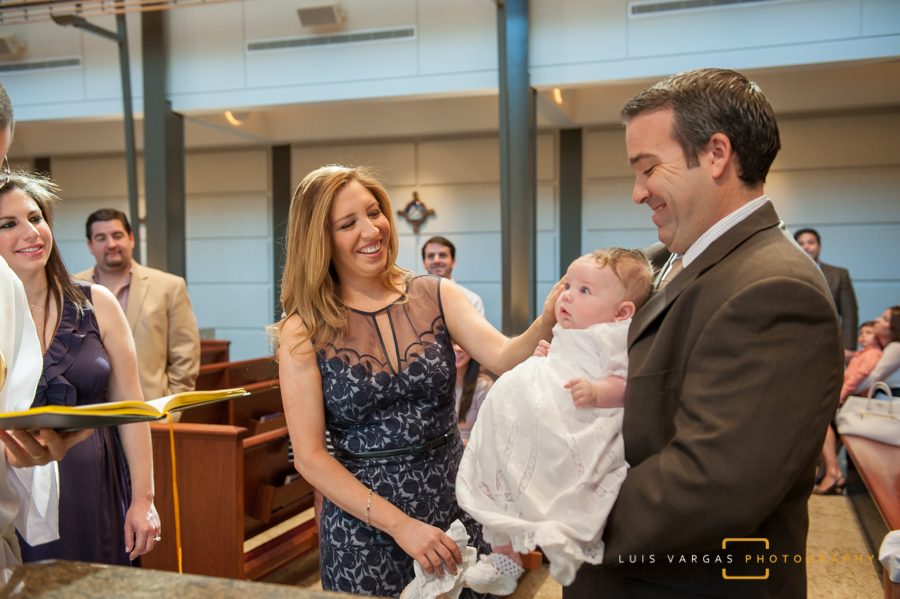 Caterina with her parents during the Baptism
