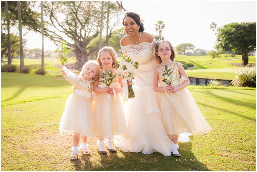 The bride posing with her flower girls