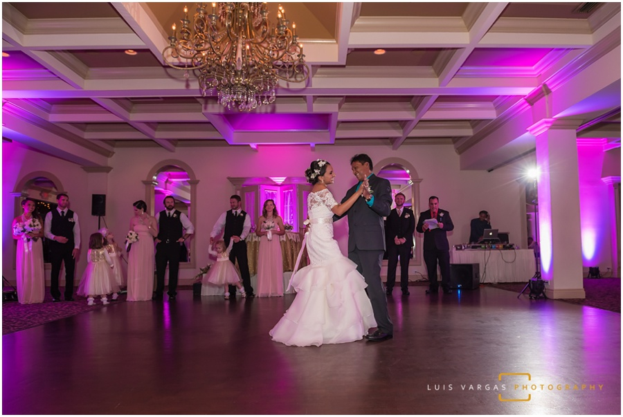 The happy bride dancing with her father