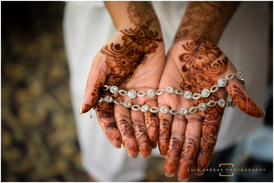 The bride showing her henna tattoo and jewelry