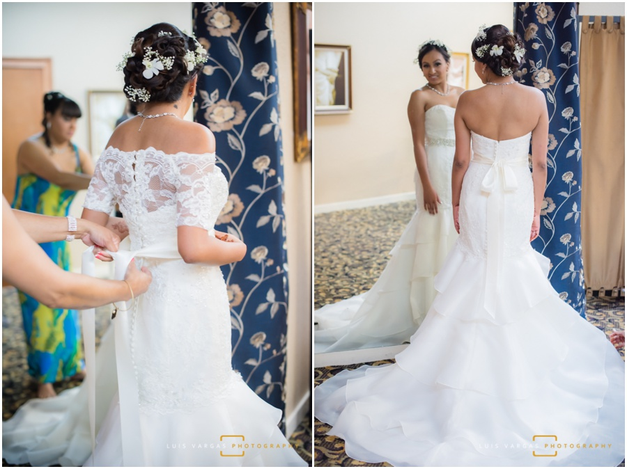 Mom helping her daughter with the wedding dress