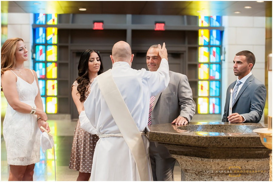 The priest blessing the parents
