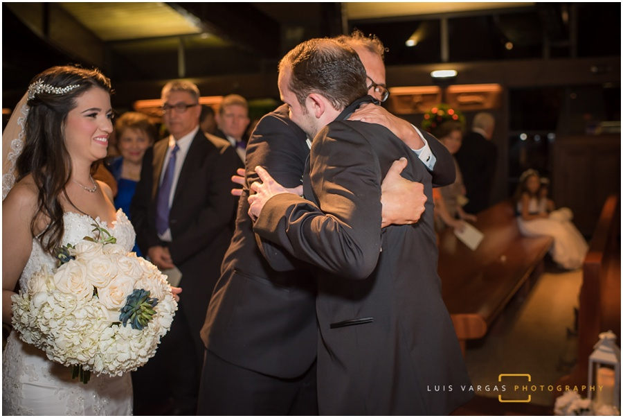 Groom hugging his father in law