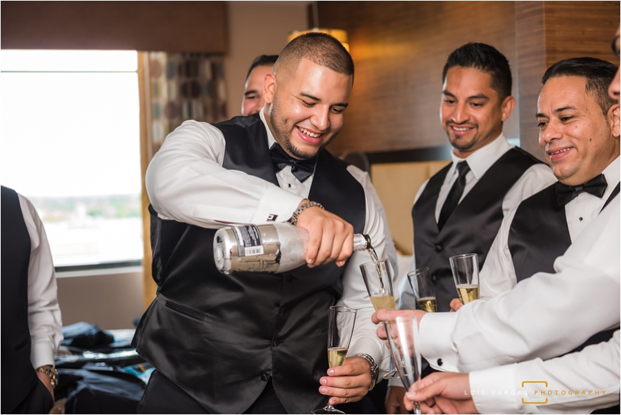 The groom and his groomsmen having a drink