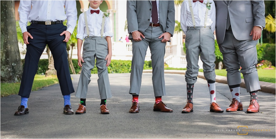 The groomsmen showing off their socks