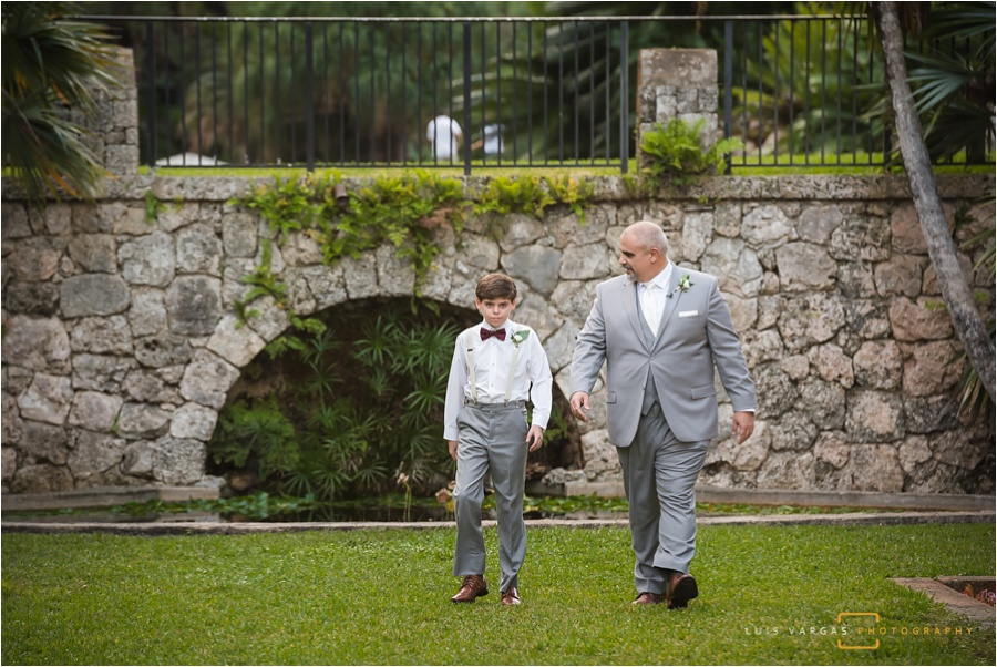 The groom and son walking down the aisle